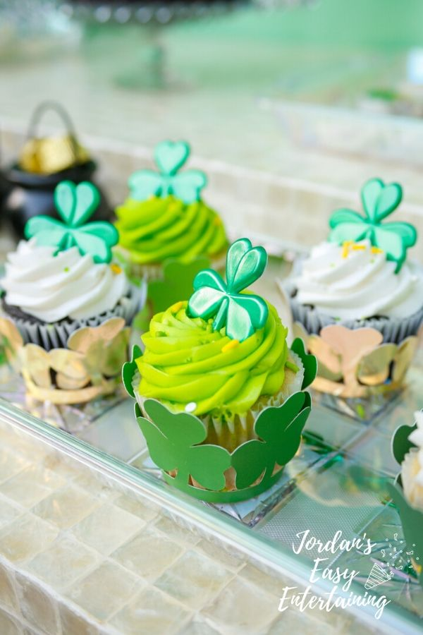 green and white cupcakes with shamrock cupcake wrappers