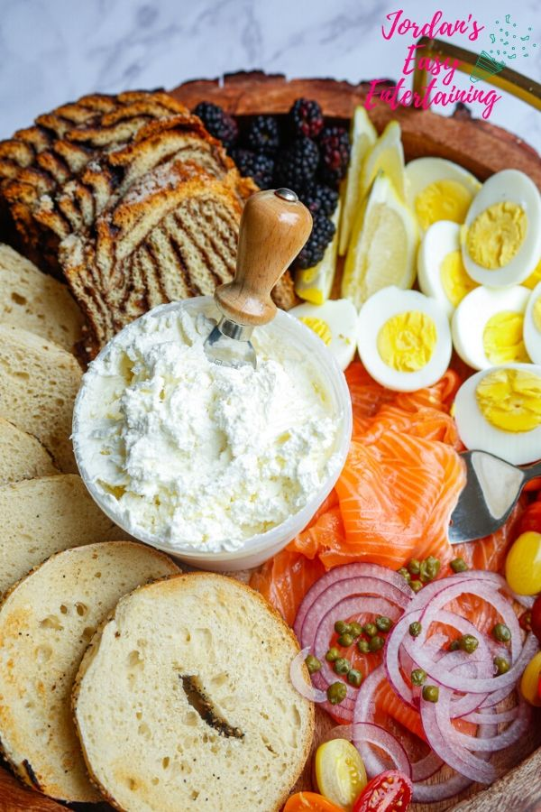a brunch idea - bagels, lox, cream cheese, capers, onion, tomatoes, and boiled eggs