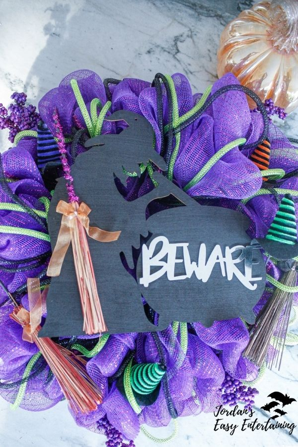 a diy Dollar Tree Halloween wreath with a witch cutout