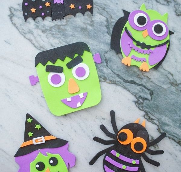 Dollar Tree Halloween crafts for kids all assembled - a bat, an owl, Frankenstein, a witch, and a spider