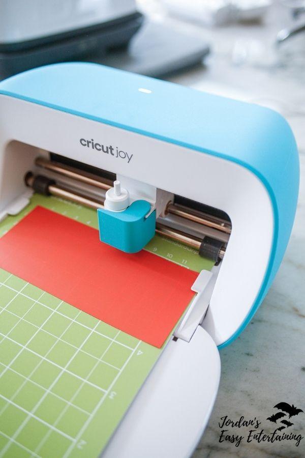 A Cricut Joy machine in use