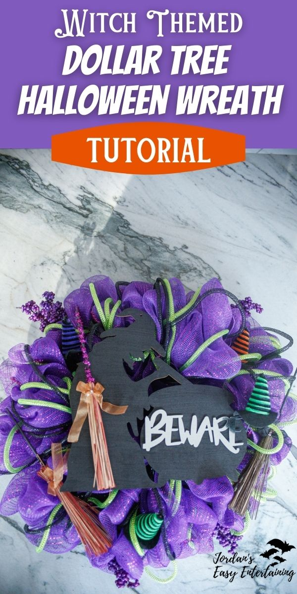 a purple witched themed dollar tree diy wreath with a black witch silhouette