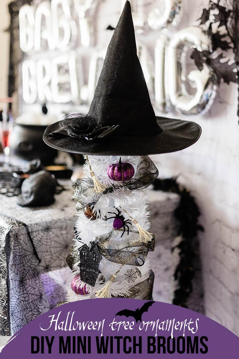 a Halloween tree with diy witch broom ornaments