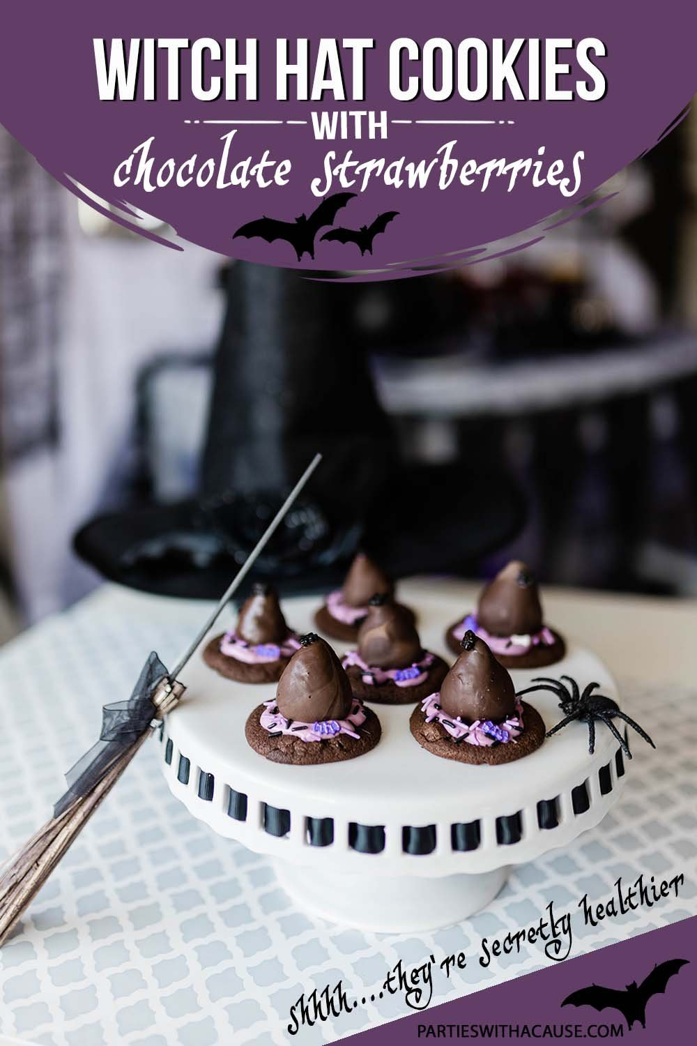 witches hat cookies on a white cake stand