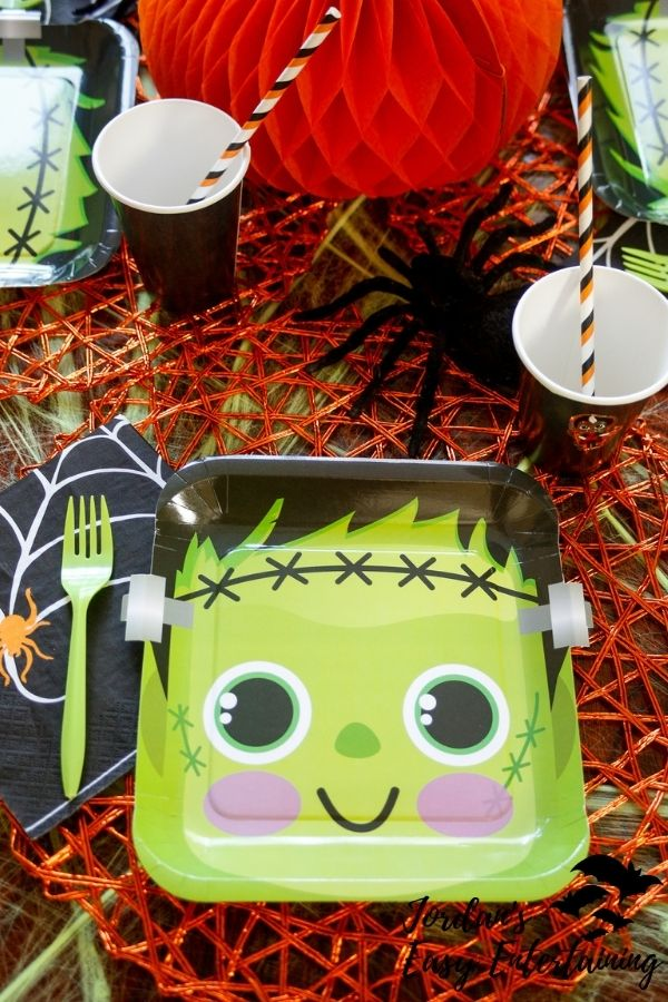 Frankenstein paper plates as part of a Halloween table setting for kids