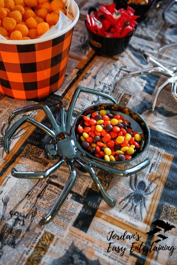 a spider candy dish with chocolate coated candies