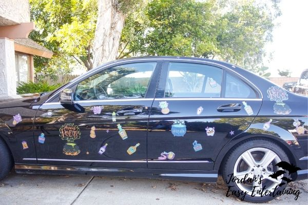 a black car with window cling Halloween parade decorations