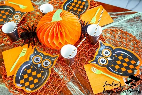 owl plates and a pumpkin centerpiece on a kid friendly Halloween tablescape