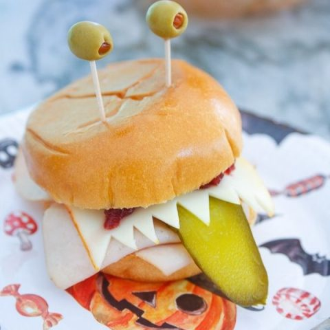 olive eyes, a pickle tongue, and cheese teeth make this silly monster sandwich